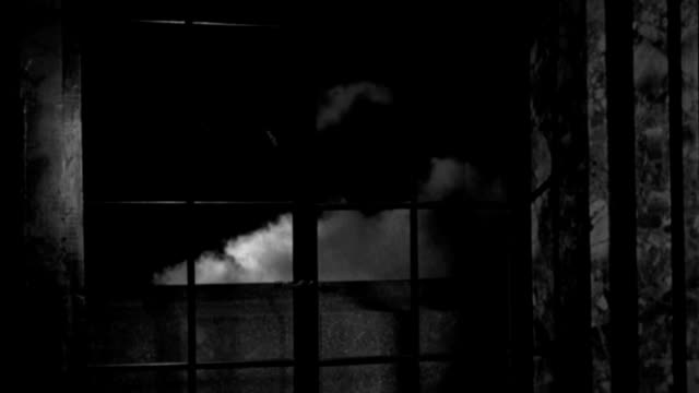 a window overlooking a large cloud of smoke shatters during an air raid. - 1941 stock videos & royalty-free footage