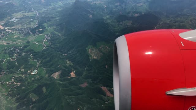 window seat airplane and engine view with fresh green mountain - boeing 737 stock videos & royalty-free footage