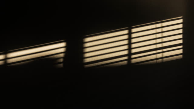 window shades motion on the wall 4k dci - tapparella video stock e b–roll