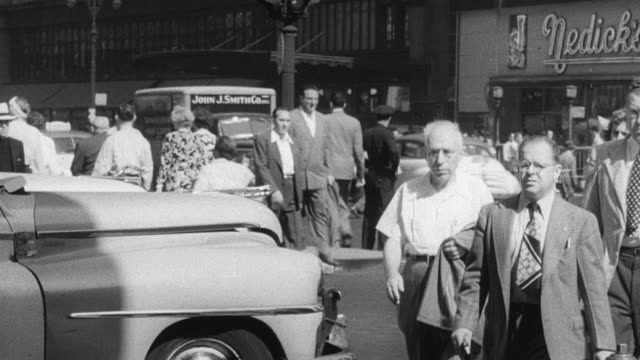 1949 montage window shoppers browsing imported clothing and linens with prominent price markers / new york city, new york, united states - インフレ点の映像素材/bロール