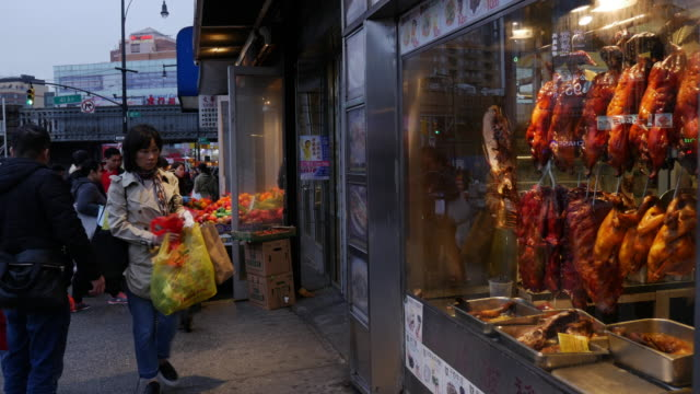 window shopping at chinese food store in flushing, queens, new york - roast chicken stock videos & royalty-free footage