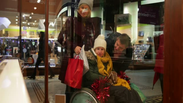 window shopping at christmas time - scoliosis stock videos and b-roll footage