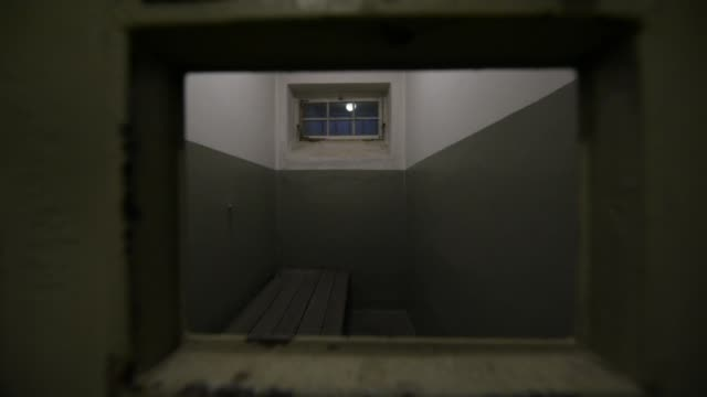 a window shows the former arrest cells of the buchenwald concentration camp on january 26 2018 near weimar germany tomorrow january 27 is... - campo di concentramento di buchenwald video stock e b–roll