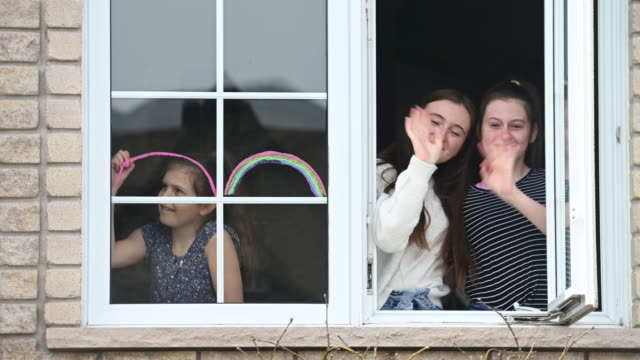 window sisters portrait at home with pet dog and rainbow symbol - neighbor stock videos & royalty-free footage