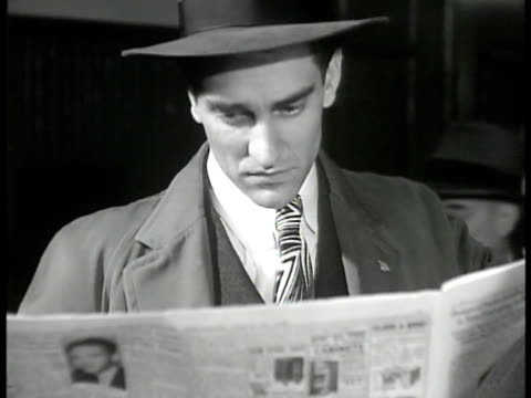 stockvideo's en b-roll-footage met window 'the morning news' newspaper office man standing outside reading paper cu manhattan apartment listings west side east side man sitting in... - 1946