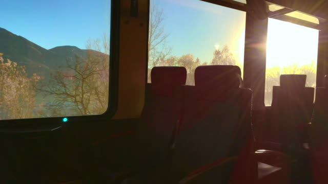 Window View From Inside a Train Wagon with Sunbeam and Mountain