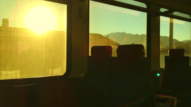 Window View From Inside a Train Wagon with Sunlight and Mountain
