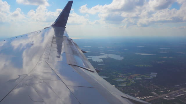 window view of flight to orlando, usa - aircraft wing stock videos & royalty-free footage