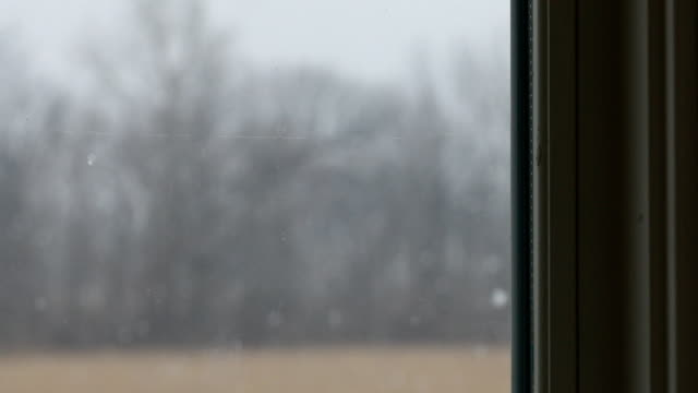 window view of snow falling - snowing stock videos & royalty-free footage