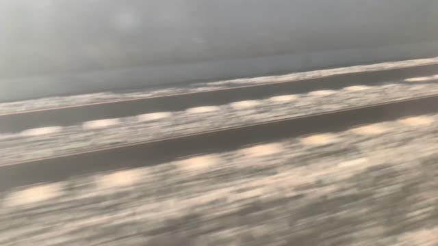 window view on railroad track from tgv speed train - tgv点の映像素材/bロール