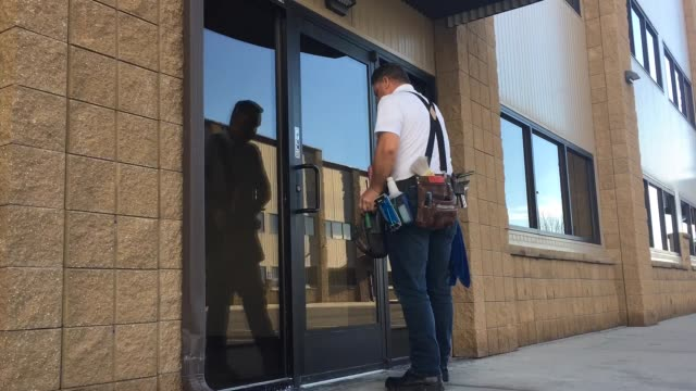 window washer cleans building doors time lapse - suspenders stock videos and b-roll footage