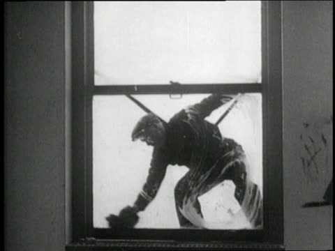 a window washer scrubs a window - window washer stock videos & royalty-free footage