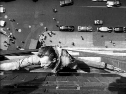 b/w 1945 overhead window washer working high above nyc street below / educational - window washer stock videos & royalty-free footage
