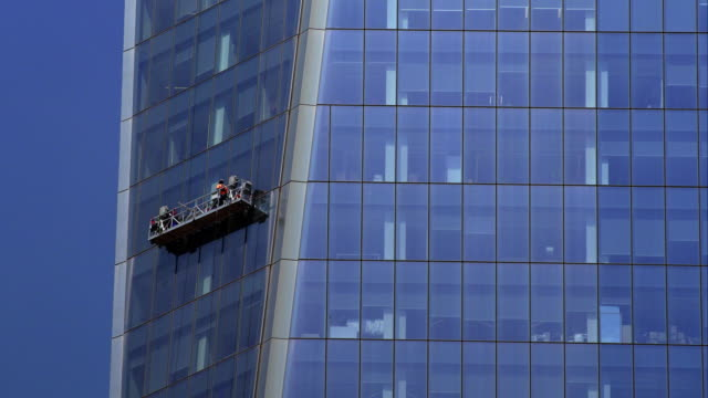 window washers move down one level of world trade center. - window washer stock videos & royalty-free footage