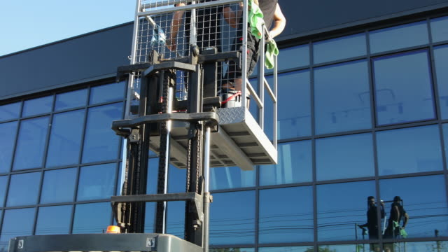 window washers preparing to get the job done - facade stock videos & royalty-free footage