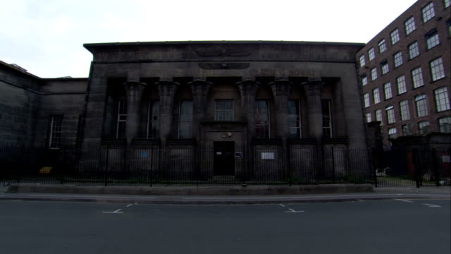 windows and columns front the temple works building in leeds. available in hd. - leeds stock videos and b-roll footage
