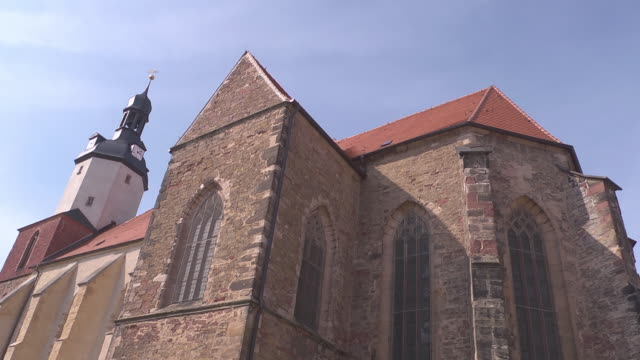 windows and tower of church st. george in mansfeld - christianity stock videos & royalty-free footage