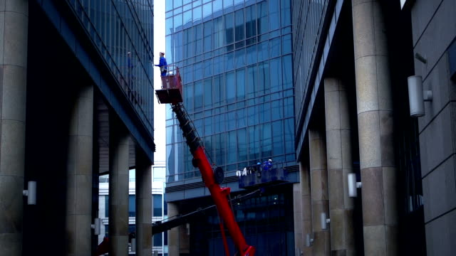 windows cleaning in a downtown district - cleaner stock videos and b-roll footage
