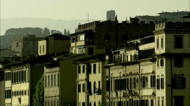 Windows cover the facades of Italian apartment buildings, Florence Available in HD.
