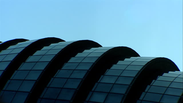 windows cover the modern exterior of london city hall. available in hd. - gla building stock videos & royalty-free footage