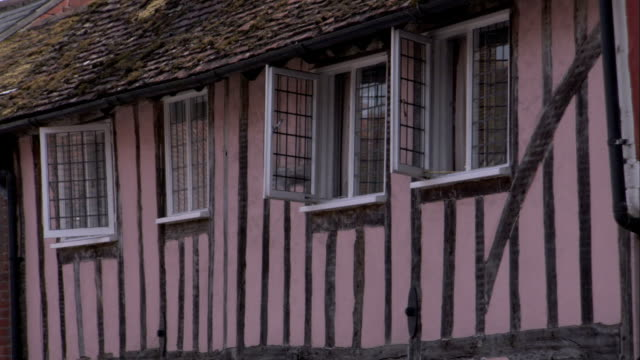 windows cover the side of a medieval cottage in lavenham. available in hd. - lavenham stock-videos und b-roll-filmmaterial
