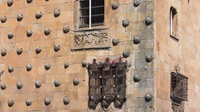 """Windows in the facade of """"Casa de las Conchas"""", Salamanca city, Salamanca province, Castilla y Leon, Spain, Europe"""