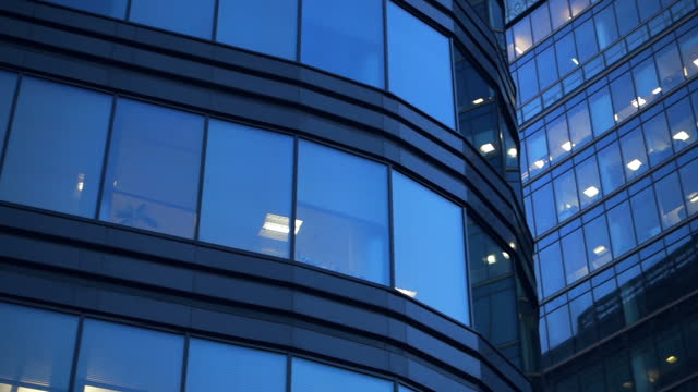 windows of a skyscraper in the evening - office block exterior stock videos & royalty-free footage