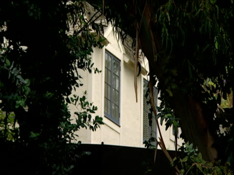 Windows of apartment through foliage Hotel Chateau Marmont Sunset Strip Los Angeles