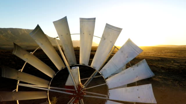 windpump boerhole karoo south africa - water wheel stock videos and b-roll footage