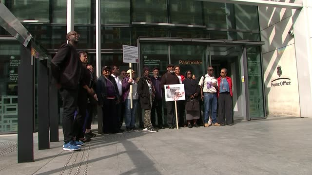 victims protest outside Home Office to mark first anniversary ENGLAND London Home Office EXT Various of demonstration outside Home Office to mark one...