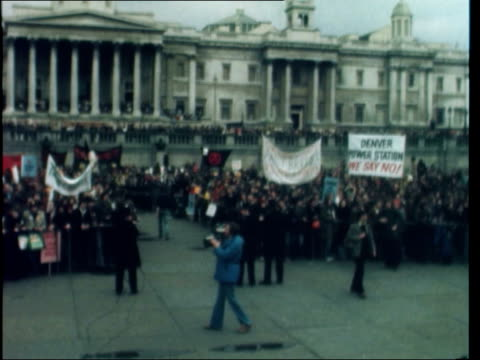 windscale demonstration; england: london: marchers towards - some in protective clothing: policewoman and demonstrators towards - some in gas masks:... - nuclear energy stock videos & royalty-free footage