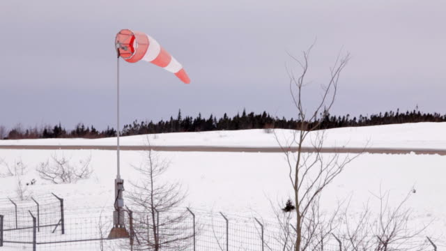 A windsock beside a runway/airstrip