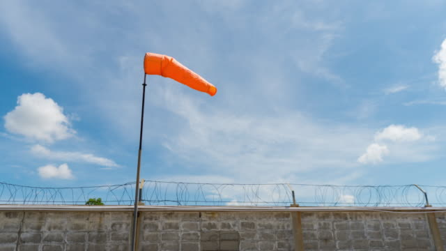 Windsock with cloudy sky