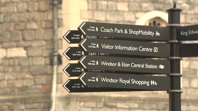 windsor castle and windsor general views; england: berkshire: windsor: ext various of statue of queen victoria / various views of windsor castle /... - directional sign stock videos & royalty-free footage