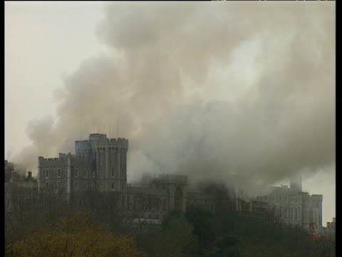 windsor castle by day with billowing smoke windsor castle fire 20 nov 92 - windsor england stock videos and b-roll footage