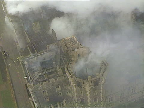 aftermath; b)16.40 england: berkshire: windsor: ext airv windsor castle with smoke rising as berks fire occurs airv ditto - the alphabet stock videos & royalty-free footage
