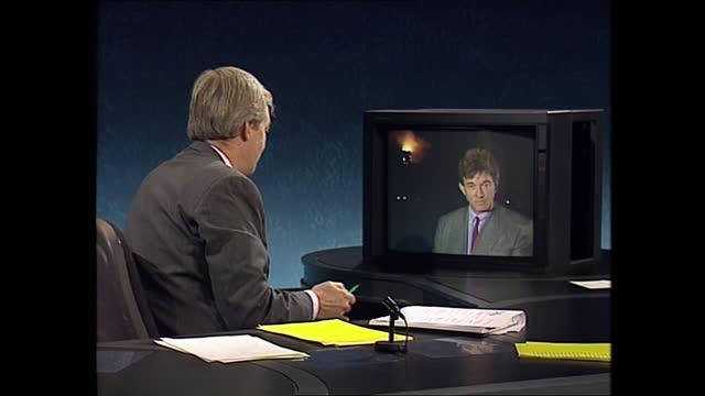 channel 4 news pab; england: london: gir: int jon snow live studio berkshire: windsor: windsor castle: ext / night fire burning in brunswick tower... - film composite stock videos & royalty-free footage