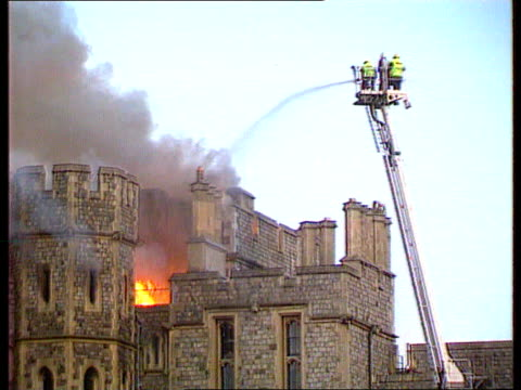 windsor castle fire itn england berks windsor castle seq castle on fire firemen at work crowd - windsor england stock videos and b-roll footage