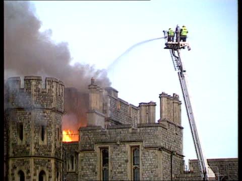 Windsor Castle Fire ITN ENGLAND Berks Windsor Castle SEQ Castle on fire firemen at work crowd