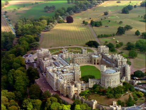 aerial windsor castle in english countryside - windsor castle stock videos & royalty-free footage