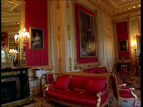windsor castle restoration:; england: berkshire: windsor castle: portrait of queen mother on wall gv crimson drawing room tms bright carpet pull out - windsor england stock videos & royalty-free footage