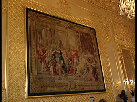 itn england berkshire windsor castle gold decorated restored ceiling tilt down to chandeliers gv tapestry on wall gv room with people milling about... - windsor england stock videos & royalty-free footage