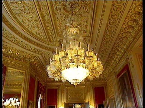itn england berkshire windsor castle int pan across restored crimson room gold decorated ceiling tilt down to large chandelier peter riddington... - windsor england stock videos and b-roll footage