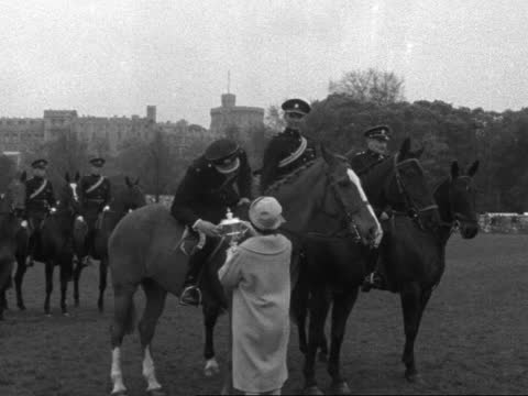 windsor horse show; england: berkshire: windsor: ext pairs of children on ponies along 'traps - horses' heads held trap past soldiers over jump -... - horse stock videos & royalty-free footage