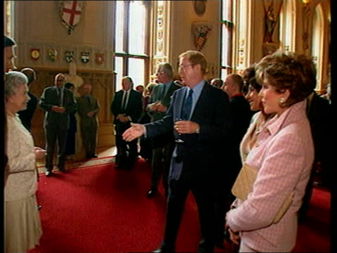 POOL ENGLAND Berkshire Windsor Castle Guests in St Georges Hall ZOOM IN Queen Elizabeth Michael Caine Shirley Bassey Joan Collins as shake hands with...