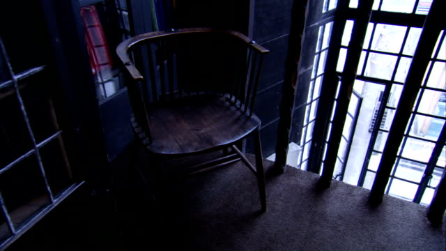 A Windsor-style wooden chair fills the corner of a balcony at the Glasgow School of Art. Available in HD.