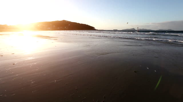 windsurf and kitesurf by the sea at sunset - galicia stock videos & royalty-free footage