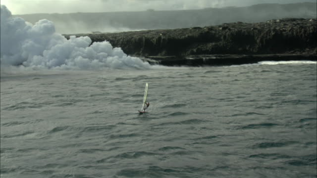 aerial ws windsurfer and smoking volcano, hilo, hawaii, usa - hilo stock videos & royalty-free footage