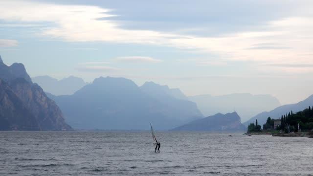 Windsurfer in the morning on the lake, Malcesine, Lake Garda, Veneto, Italy
