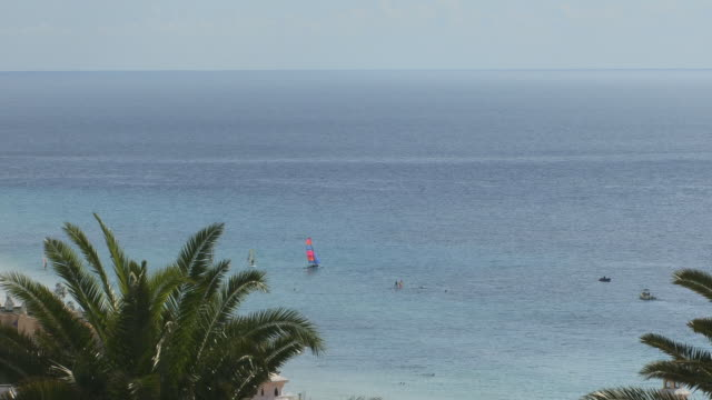 HA WS Windsurfers on ocean/ PAN crowded beach and ocean horizon/ Morro Jable, Fuerteventura, Canary Islands